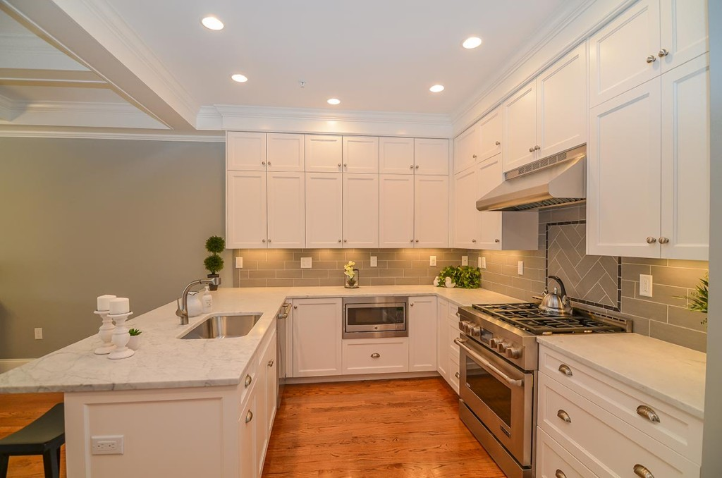 Each kitchen includes top of the line Jenn Air stainless steel appliances