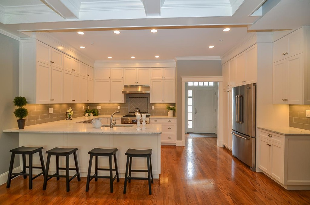 Kitchens feature either a breakfast bar or island